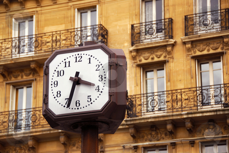 Clock in Paris stock photo, Public clock in Paris on background of old apartment building by Elena Elisseeva