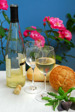 White wine still life stock photo, Table setting with chilled white wine and glasses by Elena Elisseeva