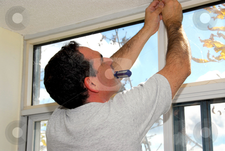 Handyman stock photo, Man installing window blinds in a house by Elena Elisseeva