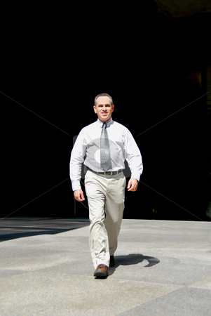 Businessman walk stock photo, Businessman walking from darkness to light by Elena Elisseeva