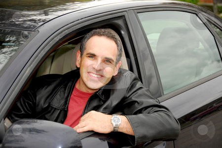 Man in car stock photo, Smiling man looking from a car window by Elena Elisseeva