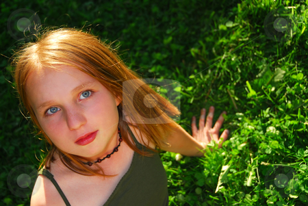 Girl grass stock photo, Young pretty girl sitting on green grass outside by Elena Elisseeva