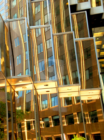 Skyscraper fragment stock photo, Reflections in a golden mirror glass wall of a skyscraper by Elena Elisseeva