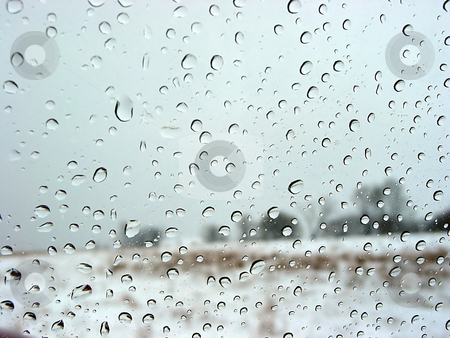 Water droplets stock photo, Water droplets on a car window, winter landscape in the background by Elena Elisseeva