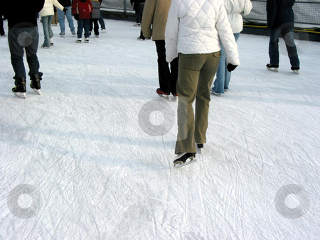 Skating 1 stock photo, Ice skating on a city skating rink by Elena Elisseeva