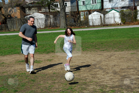 Father daughter family stock photo, Father and daughter having fun playing soccer by Elena Elisseeva