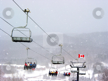 Skiers on chairlift stock photo, Chairlift at Horseshoe ski resort during heavy snowfall by Elena Elisseeva