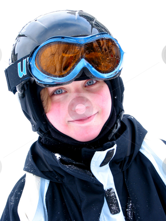 Girl ski smile stock photo, Cute young girl wearing ski helmet and goggles smiles after a day of skiing by Elena Elisseeva