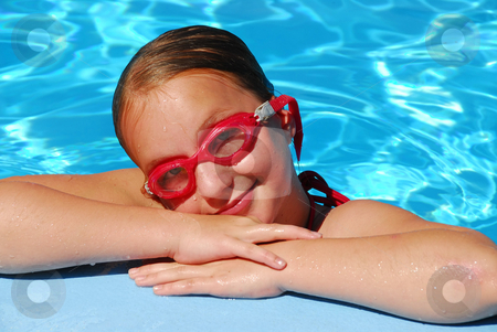 Girl portrait pool stock photo, Portrait of a young girl in red goggles resting at the pool edge by Elena Elisseeva