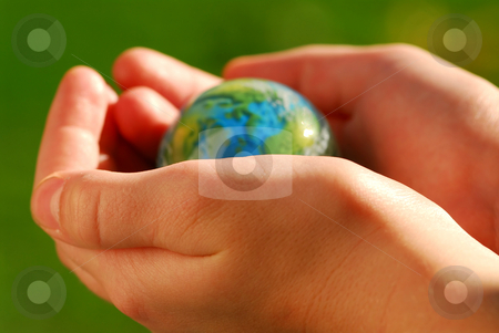 Hands globe stock photo, Child's hands holding a globe on green background by Elena Elisseeva