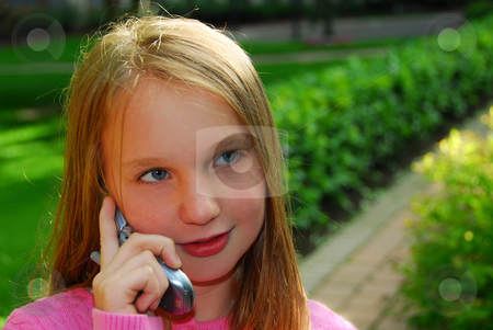 Girl phone stock photo, Preteen girl talking on cell phone outside by Elena Elisseeva