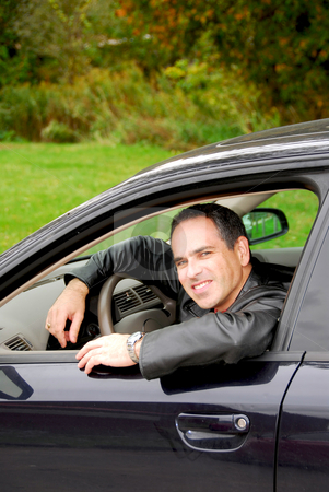 Man in car stock photo, Smiling happy man looking from a car window by Elena Elisseeva