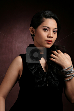 Glamour fashion portrait stock photo, Portrait of a pretty asian lady in dark background by Jonas Marcos San Luis