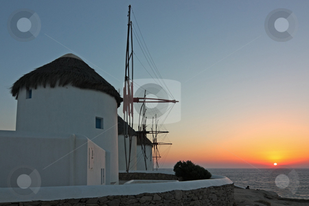 Mykonos Windmills at Sunset stock photo, The famous windmills of Mykonos island (Greece) at sunset by Georgios Alexandris