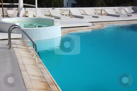 Hotel Swimming Pool stock photo, A part of the swimming pool of a hotel by Georgios Alexandris