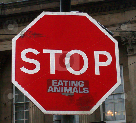 Stop Eating Animals stock photo, A sticker added to a street 'STOP' sign to create an animal rights protest by Philippa Willitts
