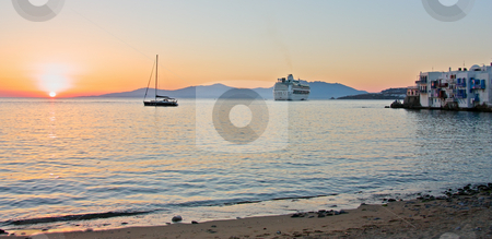 Sunset at Mykonos Island stock photo, Mykonos town, a cruise ship, a and yacht during sunset (Greece) by Georgios Alexandris
