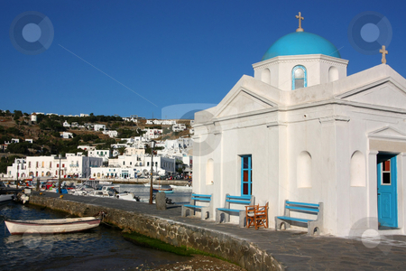 Mykonos Old Port stock photo, The old port of Mykonos island, with a little white church in the foreground by Georgios Alexandris