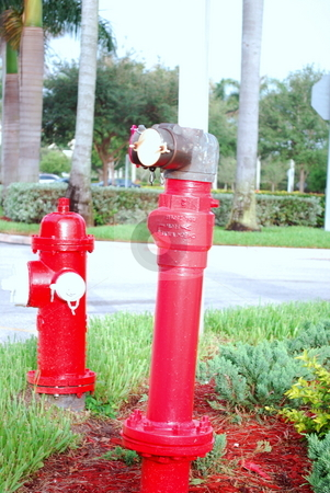 Red Fire Hydrant and Pipe stock photo,  by Robert Cabrera