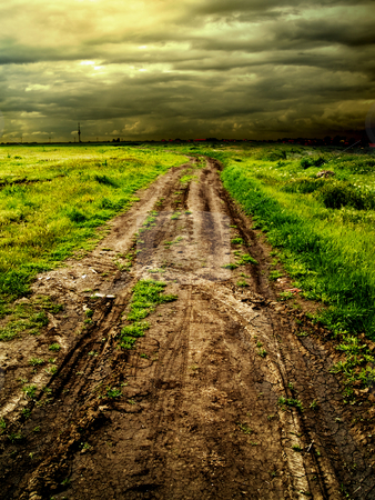 Country road stock photo, Country road muddy whith tire tracks imprinted by Adrian Costea