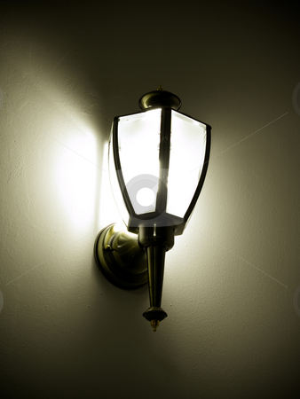 Wall lamp stock photo, Wall lamp throuwing shadows around by Adrian Costea