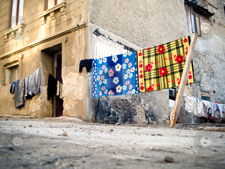 Dry laundry stock photo, Dry laundry on wire in the gypsy neighborhood by Adrian Costea