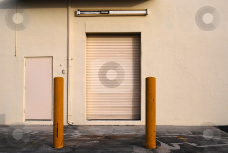 Loading Door stock photo, Loading door at the rear of a small business by Robert Cabrera