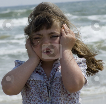 Listening to Waves stock photo, Young child listening to the song of the waves crashing behind her. by Marburg