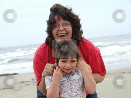 Fun at the Beach stock photo, Adult woman and child playing at the beach by Marburg