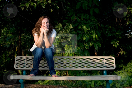 Girl on park bench stock photo,  by Jose Wilson Araujo