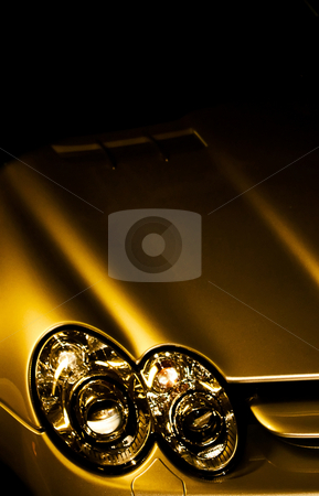 Headlights on yellow sportscar stock photo, Closeup of headlights on a yellow sports car by Jose Wilson Araujo