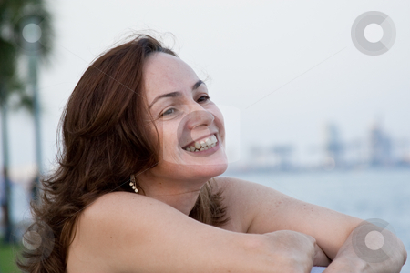 Beautiful woman at the beach stock photo, Portrait of a 40s woman at the beach by Jose Wilson Araujo