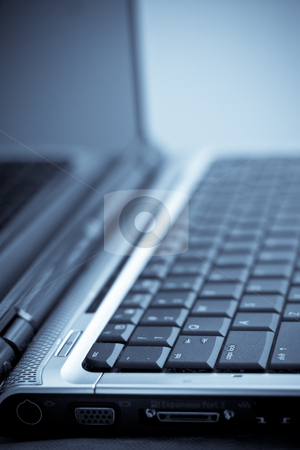 Computer Keyboard stock photo, Side view of a computer screen and keyboard by Jose Wilson Araujo