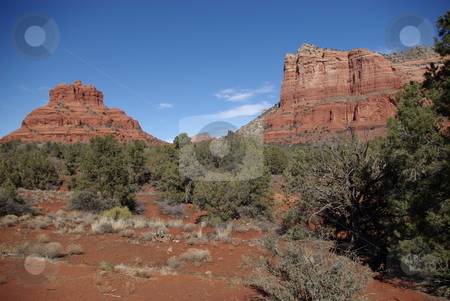 Sedona, Arizona  Red Rock Formations stock photo, Geological processes have been at work in Sedona, Az for over 300 million years creating unusual rock formations like those in this image.   The area around Sedona is referred to  as Red Rock Country and draws travelers from all over the world to view the spectacular scenery created by erosion and weathering of the desert terrain. by Dennis Thomsen