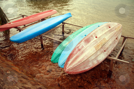 Canoes stock photo, A bunch of plastic canoes for rent on a nearby beach resort by Jonas Marcos San Luis