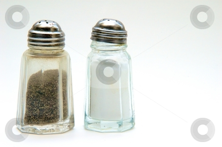 Salt and Pepper Shaker stock photo, A salt and pepper shaker on a white background by Josh Lee