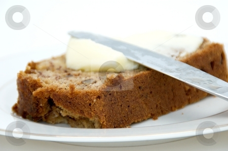 Banana Bread stock photo, A slice of banana bread with butter. by Josh Lee