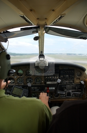 Small Aircraft (Airplane) Cockpit stock photo, The interior of a small aircraft, with the runway visible out the window.  Landing by Josh Lee