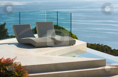 Custom Luxury Pool and Chairs stock photo, Custom Luxury Pool and Chairs Abstract Overlooking the Ocean by Andy Dean