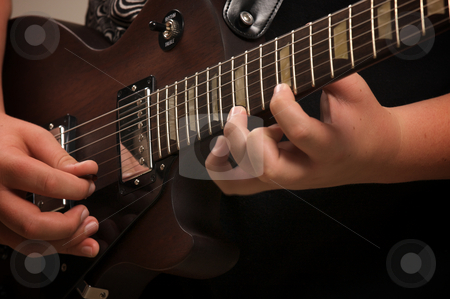 Musician Plays His Gibson stock photo, Musician Plays His Gibson Les Paul Studio Electric Guitar by Andy Dean
