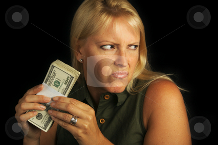 Greed stock photo, Attractive Woman Gets Greedy About Her Stack of Money by Andy Dean