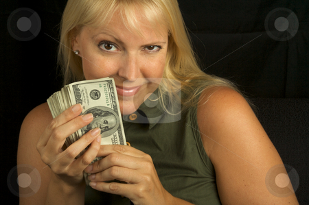 One Happy Day stock photo, Attractive Woman Excited About her Stack of Money She Holds. by Andy Dean