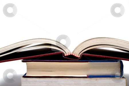 Books stock photo, A stack of books ready to be studied. by Robert Byron