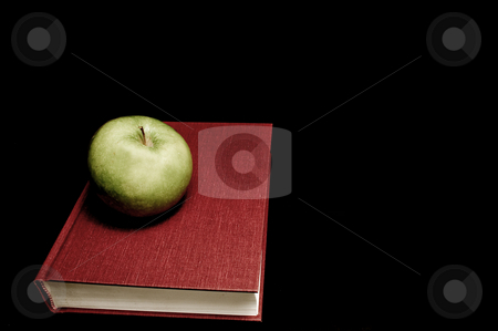 Back to School stock photo, Back to School Concept - An apple on a book. by Robert Byron
