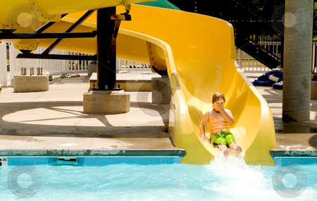 Boy on a Waterslide stock photo, A young boy sliding down a water slide. by Robert Byron