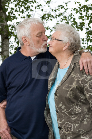 Older couple outside and in love stock photo, Outside portrait of an elderly couple loving by Frenk and Danielle Kaufmann