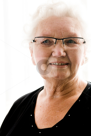 Portrait of a grandmother stock photo, Portait of an elderly woman by Frenk and Danielle Kaufmann