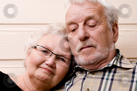 Loving at old age stock photo, Portrait of an elderly couple enjoying each others company by Frenk and Danielle Kaufmann