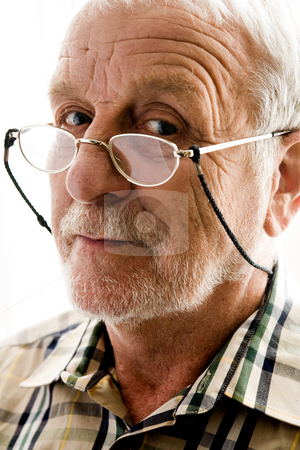 Very interested older man stock photo, Portrait of an elderly man with reading glasses by Frenk and Danielle Kaufmann