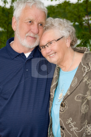 Loving at old age stock photo, Outside portrait of an elderly couple enjoying each others company by Frenk and Danielle Kaufmann